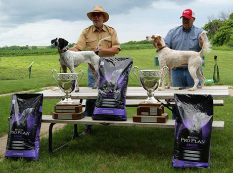 Jeff Hintz, left, and Dave Moore pose their winning dogs, CH JTH Izzie and 2X CH/RU-CH I'm Blue Gert.
