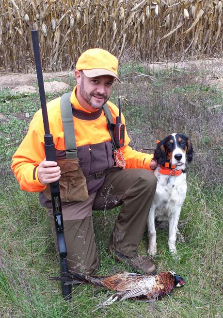Drew with Stoeger (Ridge Creek Cody x Northwoods Chardonnay, 2013) with a pheasant in Minnesota.