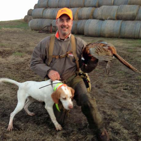 Joe, owner of Buddy (Elhew G Force x Northwoods Vixen, 2013) with pheasants in South Dakota.