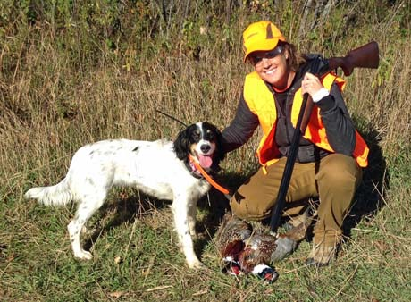 Jessica with Mac (Blue Shaquille x Houston's Belle's Choice, 2013) with pheasant in Minnesota.