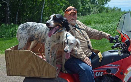 Dan Stadin often commutes from his home across the road on a four wheeler. He loves bird dogs and always owns a couple, including Slash (Houston's Blackjack x Northwoods Chardonnay, 2011), on left, and Tasha (Blue Shaquille x Snyder's Liz, 2012).
