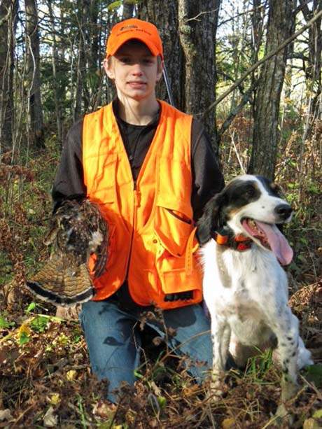 Here is a photo of our youngest son Ryan with his first grouse. It was shot off a beautiful point by Tia (Northwoods Blue Ox x Northwoods Chablis, 2011) a few weeks ago. We've been out hunting grouse every weekend. Tia still lives to hunt. Wish I was able to shoot better for her. ~ Ken, Minnesota