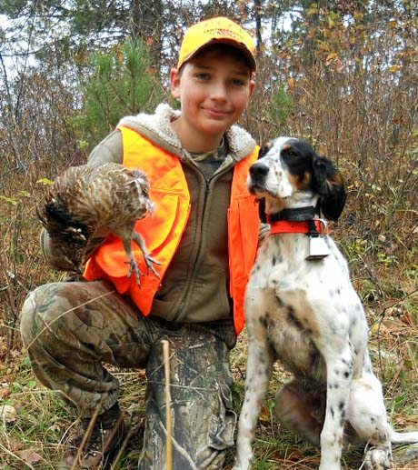 That's our youngest, Rece, with his first-ever ruffed grouse in central Minnesota. Both he and Finn (Northwoods Blue Ox x Northwoods Chablis, 2014) were elated. So proud of him for a 9-month-old pup! He's bumping birds frequently but is learning from each encounter. On one bird he locked up 70 yards in front of me and held 5 minutes or more until I busted through a bog to get to him and flush the bird. And then, he won't even give me time to praise him afterwards – he retrieves and then takes off looking for more! Feeling pretty fortunate to have one of your dogs – especially from Oscar. ~ Todd, Minnesota