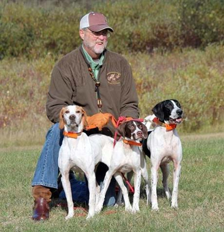 After a day in the woods, Mark Fouts proudly shows off his trio of female pointers: Prancer, on left, with her daughters Jordy and Timber.